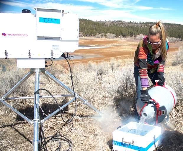 Marta Nelson pours liquid nitrogen onto a foam target.